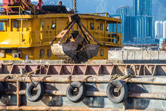 Barge dredging a harbor Royalty Free Stock Photography