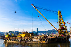 Barge dredging a harbor Stock Photography