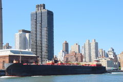 Barge on East river Royalty Free Stock Photo