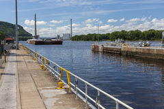 Barge Entering Lock and Dam Stock Photos