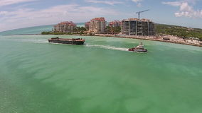 Barge entering Port of Miami aerial stock video footage