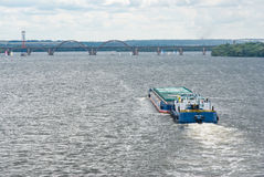 Barge float on a Dnepr river. Dnepropetrovsk, Ukraine - June 16, 2012. Barge float on a Dnepr river delivering cargo in inexpensive way to consumers stock photography
