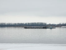 Barge floating on a fog winter river Stock Photography