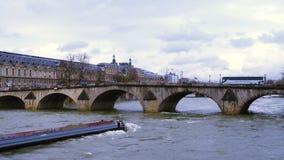 Barge floating by the Seine river. PARIS, FRANCE - MARCH 28: barge floating by the Seine river under the bridge at Paris stock footage