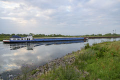 Barge floats on the channel. Water Bridge in sommer Royalty Free Stock Image