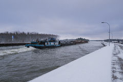 Barge floats on the channel. Water Bridge in winter Royalty Free Stock Image