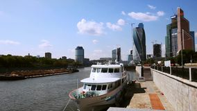 Barge floats on the Moscow river in  Moscow city. Shooting Moscow streets, life, and people canon 5D mark ii at summer 2014 stock footage