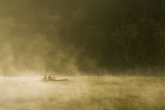 Barge in fog. Morning fog in north thailand Stock Image