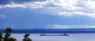 Barge on its journey on Lake Michigan Royalty Free Stock Photo