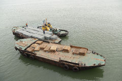 Barge. Karaginskiy Zaliv, Russia - August 19th, 2014: Karaginskiy Zaliv, delivery by barges to the vessel of frozen fish products Stock Photos