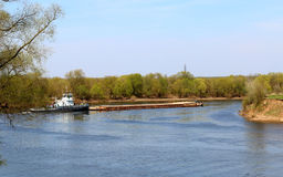 Barge in Kolomenskoye. Tug pushing a barge on the Moscow river in Kolomna, Russia Stock Image