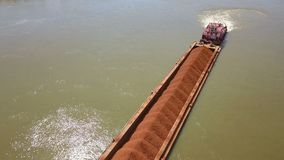 A barge loaded with ore on the Danube. Aerial view stock video footage