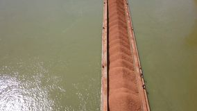A barge loaded with ore on the Danube. Aerial view stock video