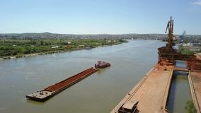 A barge loaded with ore on the Danube. Aerial view stock footage