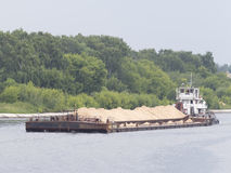 Barge loaded with sand floats Royalty Free Stock Image