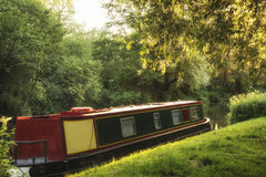 Barge long boat on canal. Beautiful Summer sunrise landscape of barge long boat on canal stock photos