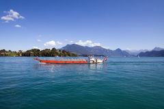 Barge on Lucerne Lake and Swiss Alps royalty free stock image