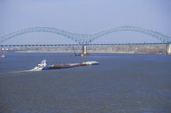 Barge on Mississippi River with Bridge and Memphis, TN in background Stock Image