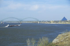 Barge on Mississippi River with Bridge and Memphis, TN in background Stock Photography