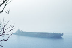 Barge in mist creates a ghostly mood Royalty Free Stock Images