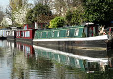 Barge moored on the canal. A Barge moored on the canal in Paddington Central, London Stock Image