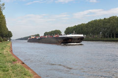 Barge navigating at Dutch canal near Amsterdam Stock Image