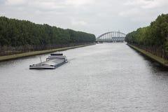 Barge navigating at Dutch canal near Amsterdam. Big barge navigating at Dutch canal near Amsterdam Royalty Free Stock Photo