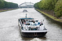 Barge navigating at Dutch canal near Amsterdam. Big barge navigating at Dutch canal near Amsterdam Stock Image