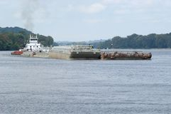 Barge on the Ohio River. A barge travels upstream on the Ohio River in Northern West Virginia Stock Images