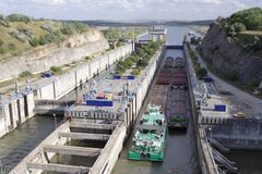 Barge passing through canal lock Royalty Free Stock Image