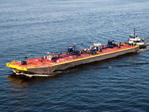 Barge pushed by a tugboat Royalty Free Stock Photo