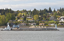 Barge pushing its cargo in the Columbia river Oregon. Royalty Free Stock Images
