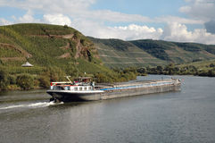 Barge on Rhine River wine region of Germany. Barge floating down the Rhine River in the wine region of Germany Royalty Free Stock Photos