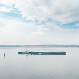 Barge on river and clouds over them Royalty Free Stock Image