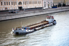 Barge at the river Stock Images