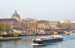 A barge on the river Seine, Paris Royalty Free Stock Images