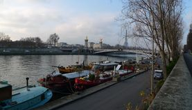 Barge on the River Seine in Paris in winter Stock Photo