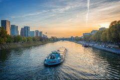 Barge on the river Seine at sunset, Paris France. Barge on the river Seine at sunset, Paris, France Stock Image