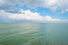 Barge sailing on the horizon of a lake Stock Photo