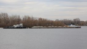 Barge with sand Stock Images