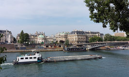 Barge on Seine river Stock Images