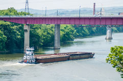 Barge ship moving on water  towards bridge Stock Photography