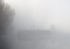Barge ship in thick fog Stock Photos