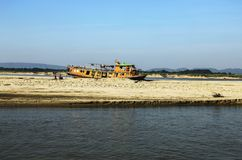 Barge standing on a shallow, used as a dwelling royalty free stock images