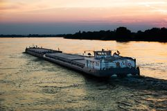 Barge at sunset Stock Image