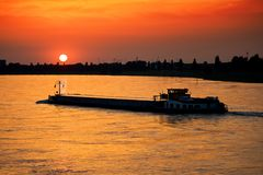 Barge at sunset. Barge with cargo at sunset Stock Photo