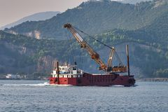 barge with on top a crane royalty free stock image