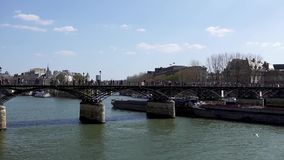 Barge trafic under Pont des Arts bridge on the Seine river - Paris