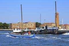 Barge transporting trucks Venice lagoon Royalty Free Stock Photo