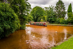 A barge travels along the water Stock Images